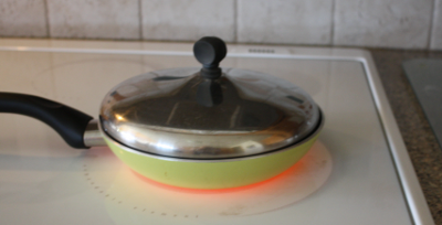 range top pan with food being heated
